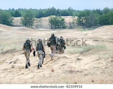 squad of german soldiers in action - stock photo