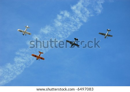 Squadron of Four Antique Aircraft including Two Biplanes