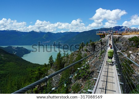 SQUAMISH, CANADA - JULY 7, 2014: People ascend to the top of new 885-metre Sea-to-Sky Gondola attraction for the majestic views of Howe Sound in Squamish, BC, Canada, July 7, 2014. - stock photo