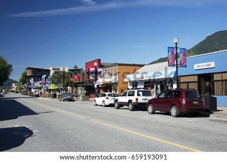 SQUAMISH - MAY 29, 2017: Popular centre of the Sea to Sky area is nestled under Coast Mountains. Pictured is Cleveland Ave, the centre of the city. British Columbia, Canada