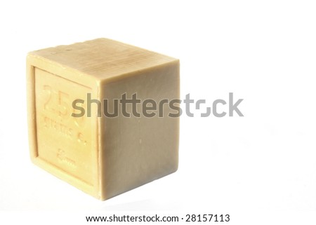 Square block of natural soap isolated against white background - stock photo