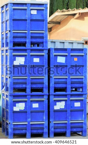 Square blue containers  stand outdoors