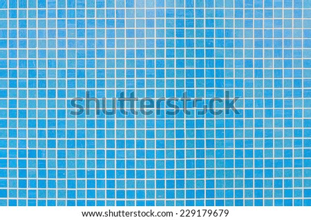 Square blue mosaic tiles texture with white filling - stock photo