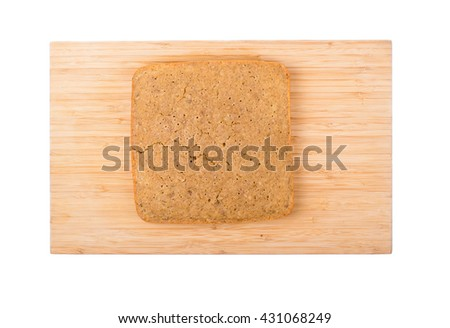 Square cake with a nut on a white background.