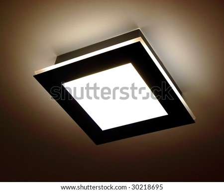 square ceiling lamp on the brown background - stock photo