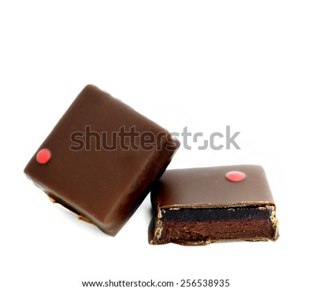 SQUARE CHOCOLATE WITH HALF CHOCOLATE STUFFED WITH GANACHE - stock photo