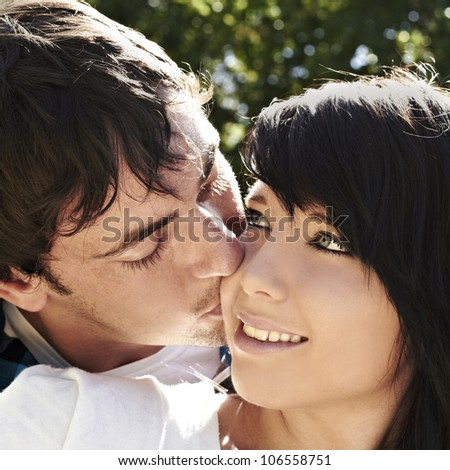 Square cropped portrait of young romantic couple