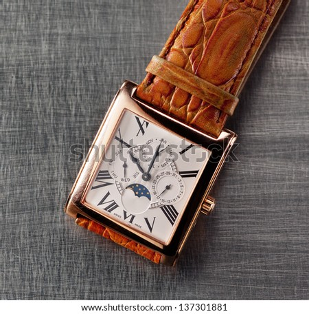Square gold watches - stock photo