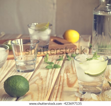 square image. Cocktail vodka or gin with ice vintage. Closeup - stock photo