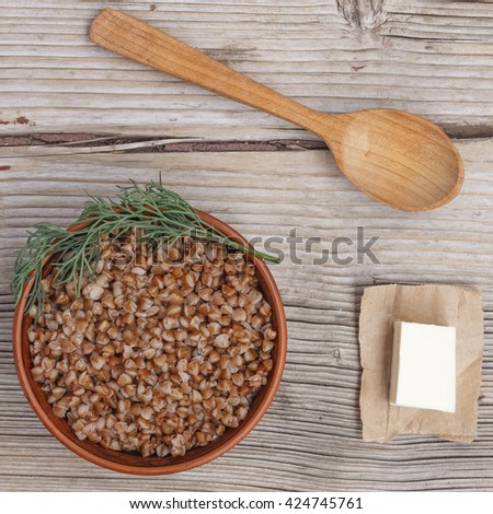 Square image. HEALTHY FOOD. Healthy food. buckwheat on a wooden background. - stock photo