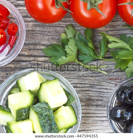 Square image. Healthy food, vegetable salad. Closeup of fresh  ingredients on a wooden table, top view - stock photo
