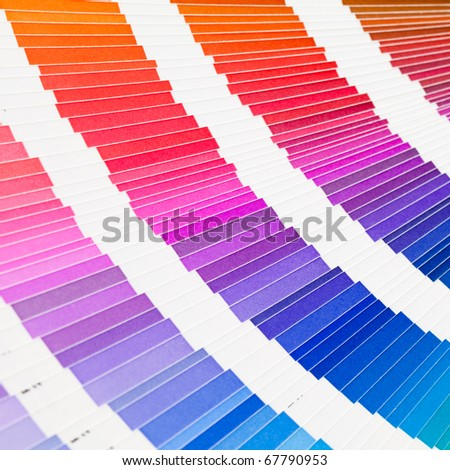 Square image of open pantone color guide sampler - stock photo