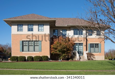 Square Modern House with Blue Trim - stock photo