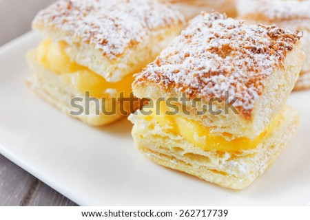 Square of cream-covered baked sugar on white font - stock photo