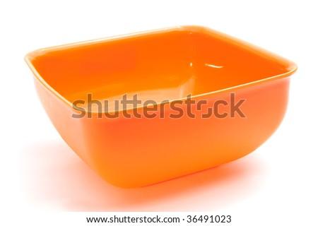 Square orange bowl, isolated on white - stock photo