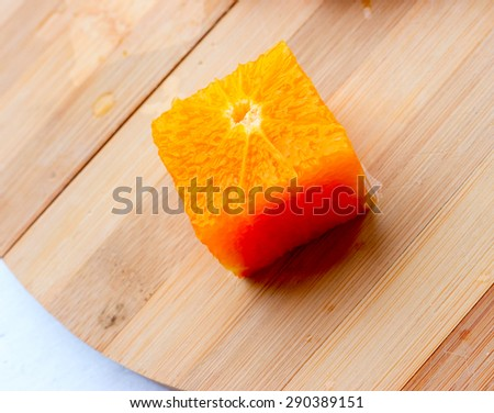 Square Orange fruit on a colored background. - stock photo