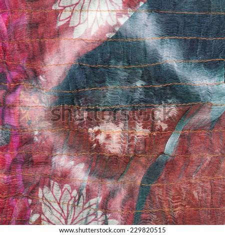 square pattern on stitched silk batik close up - stock photo