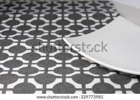 Square plate on stylish napkin placemat - stock photo