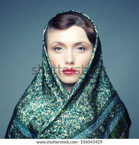 Square portrait of a Russian girl with a cold eye - stock photo
