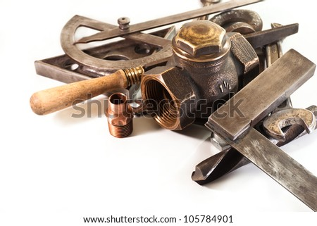 Square, protractor,file, scissors, drill, hinge, and a bronze crane on white background - stock photo