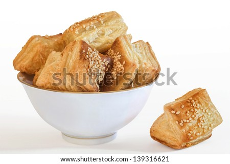 Square Puff Croissant Pastry Zu-Zu In Porcelain Bowl Isolated On White Background - stock photo