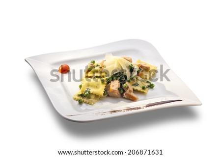 Square ravioli with green peas, pieces of meat and parmesan isolated on white background - stock photo