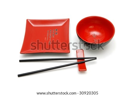 Square red plate, round bowl and chopsticks on stand isolated - stock photo