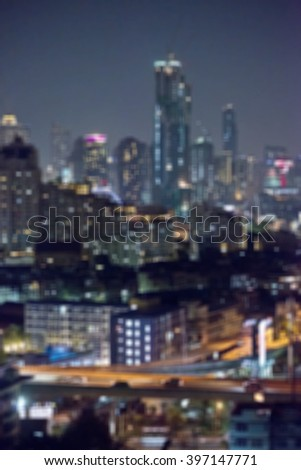Square shape of blurred city lights background after sunset.