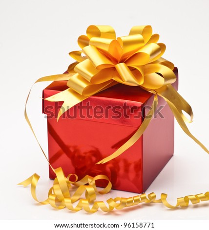 square shiny red gift box with golden ribbon isolated on white