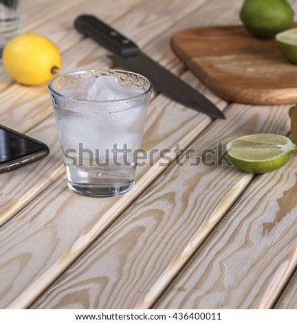 Square shot. Cocktail vodka or gin with ice vintage, tequila. - stock photo