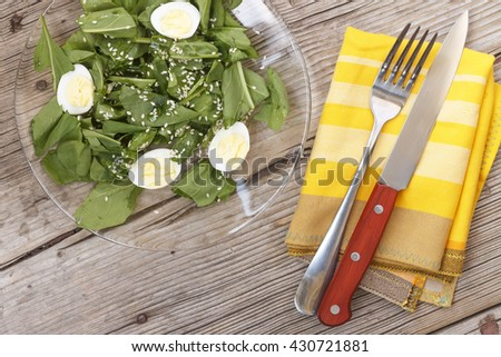 Square shot. Proper nutrition. Diet, weight loss. Spinach salad with quail eggs. Closeup - stock photo