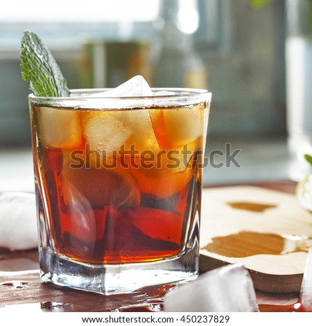 Square shot/ rum in a glass with ice