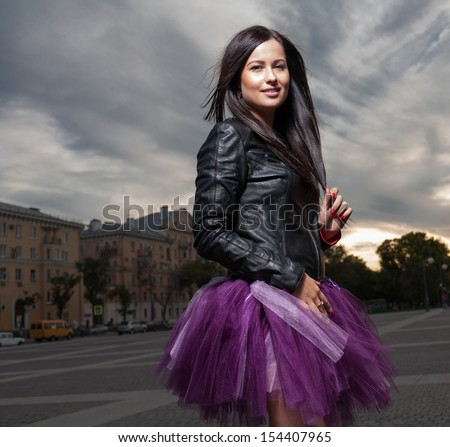 square shot sexy Russian 20s girl brunette outdoors weared black leather jacket and ballet tutu-skirt violet color - stock photo