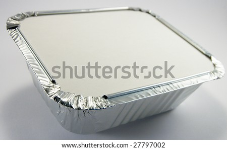 Square silver foil tray with lid on a white background - stock photo