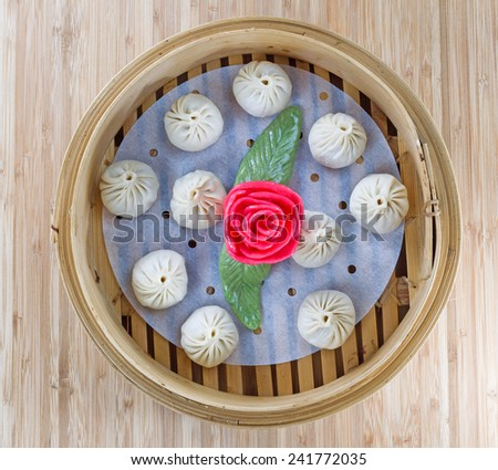 Square top view image of uncooked Chinese Dim sum in bamboo server - stock photo