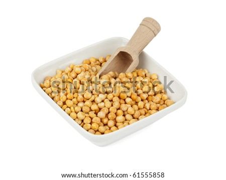 square white bowl filled with split peas, wooden shovel inside, isolated on white - stock photo