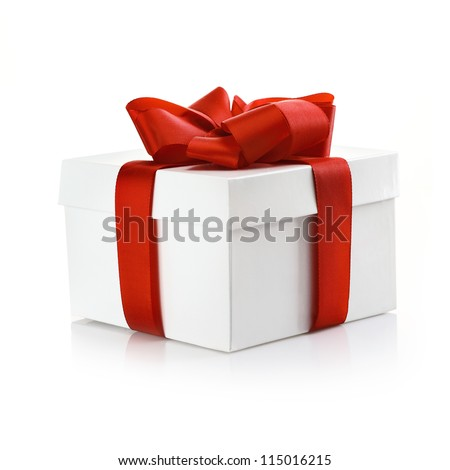Square white giftbox with lid tied with an ornamental red ribbon for celebrating Christmas, Valentine or an anniversary - stock photo