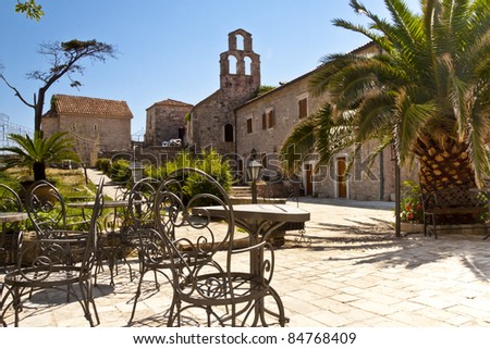 Square with old pattern table in center of Budva - Montenegro. - stock photo