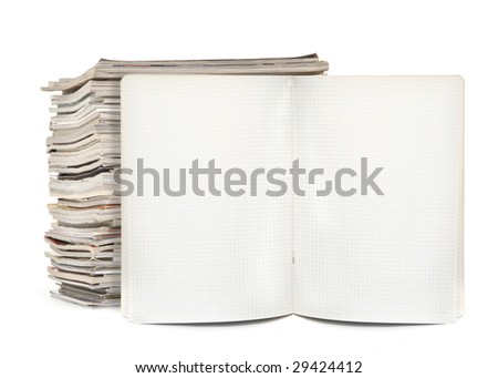 squared exercise book and magazines on white, visible natural shadow in front - stock photo
