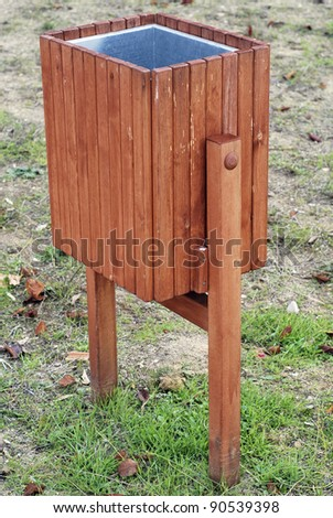 Squared litter bin in the park. Outdoors wastebasket - stock photo