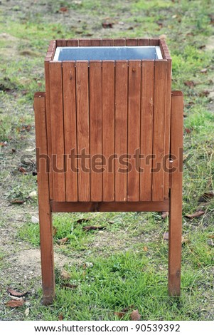 Squared litter bin in the park. Trash container - stock photo