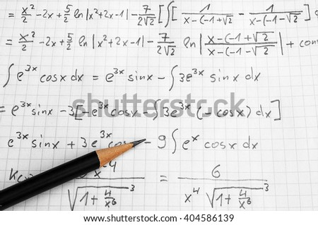 squared paper with maths-formulas and a pencil - stock photo