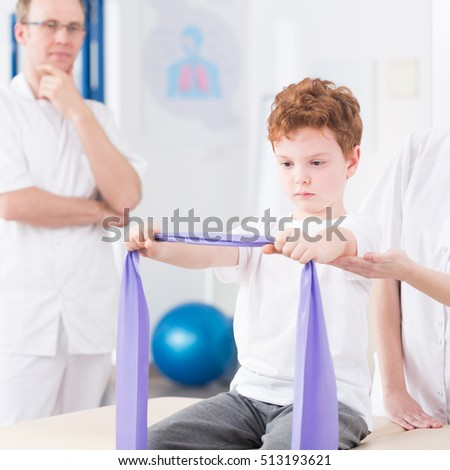 Squared picture of child training with physiotherapist