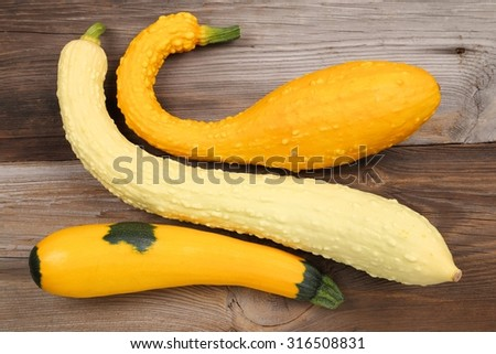 Squash  and zucchini on a wooden background. - stock photo