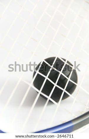 Squash ball against strings of racket with short DOF