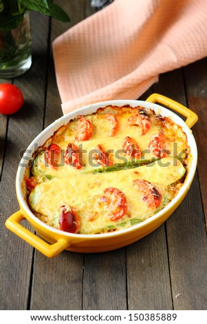 squash casserole with tomatoes, food close up