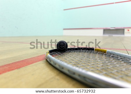 Squash court and racket with ball - stock photo