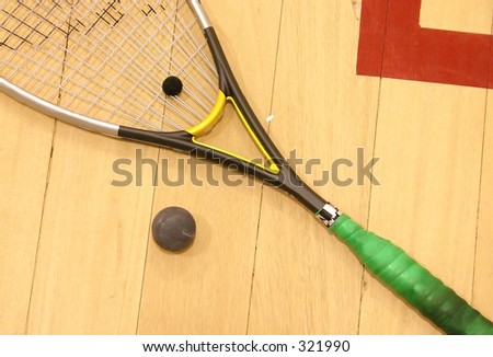 squash raquet on the floor with ball