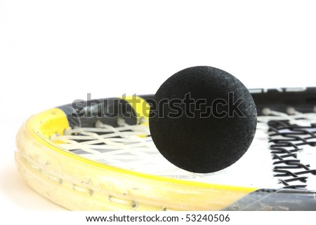 Squash rocket with two-yeallow dotted black ball - stock photo
