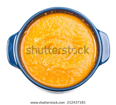 Squash soup in bowl isolated on white background - stock photo